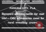 Image of dog and goose fight Panama City Florida USA, 1932, second 10 stock footage video 65675026480