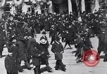 Image of crowd in city United States USA, 1908, second 1 stock footage video 65675026657