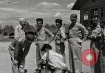 Image of prisoners receiving Red Cross packages Cebu Philippines, 1945, second 4 stock footage video 65675026777