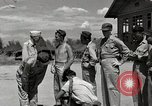 Image of prisoners receiving Red Cross packages Cebu Philippines, 1945, second 10 stock footage video 65675026777