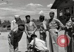 Image of prisoners receiving Red Cross packages Cebu Philippines, 1945, second 11 stock footage video 65675026777