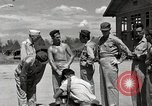 Image of prisoners receiving Red Cross packages Cebu Philippines, 1945, second 12 stock footage video 65675026777