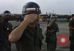 Image of Seamans inspecting and honoring VNAF troops Soc Trang Air Base Vietnam, 1970, second 12 stock footage video 65675026828