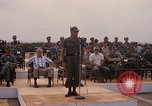 Image of Dr Seamans and other VIP'S addressing Vietnamese troops Soc Trang Air Base Vietnam, 1970, second 12 stock footage video 65675026829