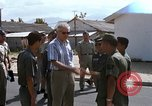 Image of Dr Seamans inspecting the training school facilities Nha Trang Air Base Vietnam, 1970, second 11 stock footage video 65675026839