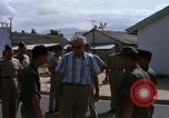 Image of Dr Seamans inspecting the training school facilities Nha Trang Air Base Vietnam, 1970, second 12 stock footage video 65675026839