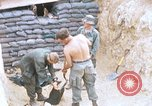 Image of US Soldiers filling sandbags during Operation Somerset Plain Vietnam, 1968, second 1 stock footage video 65675026847