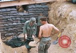 Image of US Soldiers filling sandbags during Operation Somerset Plain Vietnam, 1968, second 2 stock footage video 65675026847