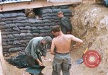 Image of US Soldiers filling sandbags during Operation Somerset Plain Vietnam, 1968, second 3 stock footage video 65675026847