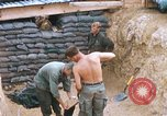Image of US Soldiers filling sandbags during Operation Somerset Plain Vietnam, 1968, second 4 stock footage video 65675026847