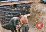 Image of US Soldiers filling sandbags during Operation Somerset Plain Vietnam, 1968, second 5 stock footage video 65675026847