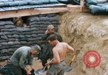 Image of US Soldiers filling sandbags during Operation Somerset Plain Vietnam, 1968, second 6 stock footage video 65675026847