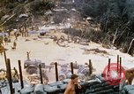Image of US Soldiers loading Howitzers and helicopter during Operation Somerset Vietnam, 1968, second 2 stock footage video 65675026850