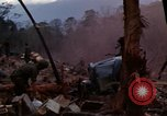 Image of Soldiers gathering equipment from Wrecked UH-1H helicopter A Shau Valley Vietnam, 1968, second 2 stock footage video 65675026858