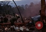 Image of Soldiers gathering equipment from Wrecked UH-1H helicopter A Shau Valley Vietnam, 1968, second 3 stock footage video 65675026858
