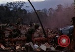 Image of Soldiers gathering equipment from Wrecked UH-1H helicopter A Shau Valley Vietnam, 1968, second 4 stock footage video 65675026858
