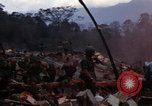 Image of Wrecked US Army UH-1H helicopter A Shau Valley Vietnam, 1968, second 5 stock footage video 65675026858