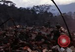 Image of Soldiers gathering equipment from Wrecked UH-1H helicopter A Shau Valley Vietnam, 1968, second 6 stock footage video 65675026858