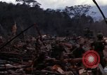 Image of Soldiers gathering equipment from Wrecked UH-1H helicopter A Shau Valley Vietnam, 1968, second 7 stock footage video 65675026858
