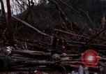 Image of Soldiers gathering equipment from Wrecked UH-1H helicopter A Shau Valley Vietnam, 1968, second 11 stock footage video 65675026858