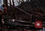 Image of Soldiers gathering equipment from Wrecked UH-1H helicopter A Shau Valley Vietnam, 1968, second 12 stock footage video 65675026858