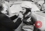 Image of boy on a motorcycle France, 1954, second 9 stock footage video 65675027004