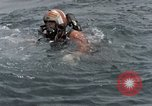 Image of jet pilot water rescue United States USA, 1965, second 3 stock footage video 65675027024