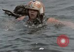 Image of jet pilot water rescue United States USA, 1965, second 10 stock footage video 65675027024