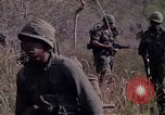 Image of United States soldiers on patrol in Vietnam War Vietnam, 1967, second 11 stock footage video 65675027034