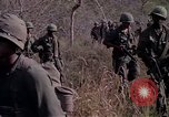 Image of United States soldiers on patrol in Vietnam War Vietnam, 1967, second 12 stock footage video 65675027034