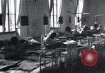 Image of Patients in hospital tended by nuns Vienna Austria, 1923, second 2 stock footage video 65675027115