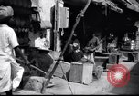 Image of Merchant  stalls Aden Yemen, 1916, second 2 stock footage video 65675027159