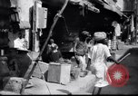 Image of Merchant  stalls Aden Yemen, 1916, second 4 stock footage video 65675027159