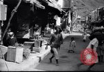 Image of Merchant  stalls Aden Yemen, 1916, second 6 stock footage video 65675027159
