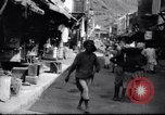 Image of Merchant  stalls Aden Yemen, 1916, second 7 stock footage video 65675027159