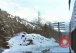 Image of Passenger train in snowy mountains United States USA, 1985, second 2 stock footage video 65675027198