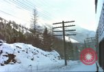 Image of Passenger train in snowy mountains United States USA, 1985, second 3 stock footage video 65675027198