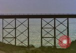 Image of Train on high trestle United States USA, 1985, second 2 stock footage video 65675027206