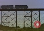Image of Train on high trestle United States USA, 1985, second 10 stock footage video 65675027206