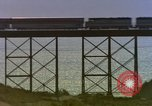 Image of Train on high trestle United States USA, 1985, second 11 stock footage video 65675027206