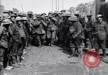Image of German prisoners carry heavy machine gun France, 1917, second 8 stock footage video 65675027242
