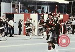 Image of band in kilts Washington DC USA, 1976, second 8 stock footage video 65675027399