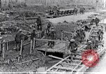 Image of British soldiers move ammunition by small gauge railroad Flanders, 1916, second 11 stock footage video 65675027527