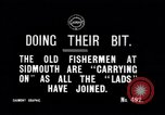 Image of Old fishermen Sidmouth England, 1916, second 2 stock footage video 65675027556