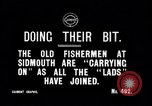 Image of Old fishermen Sidmouth England, 1916, second 4 stock footage video 65675027556
