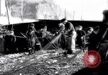 Image of Old fishermen Sidmouth England, 1916, second 8 stock footage video 65675027556