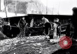 Image of Old fishermen Sidmouth England, 1916, second 10 stock footage video 65675027556