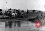 Image of French World War I soldiers cross creek Maurepas Yvelines France, 1917, second 2 stock footage video 65675027557