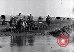 Image of French World War I soldiers cross creek Maurepas Yvelines France, 1917, second 3 stock footage video 65675027557