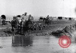 Image of French World War I soldiers cross creek Maurepas Yvelines France, 1917, second 4 stock footage video 65675027557